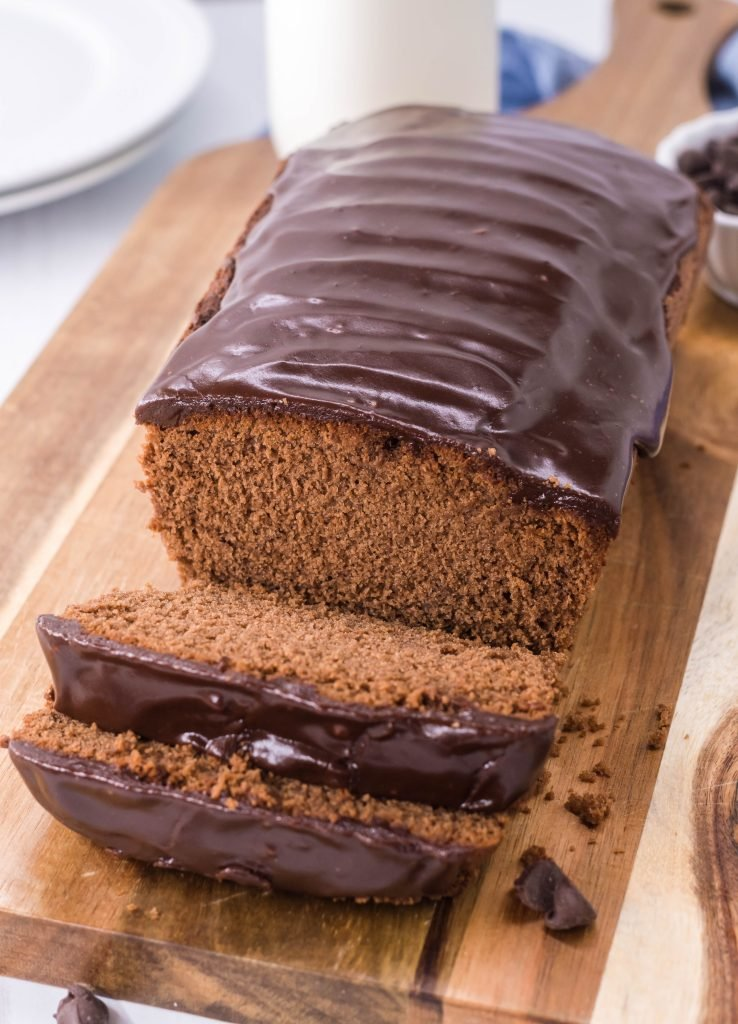 quick, easy triple chocolate bread shown on a brown cutting board and thinly sliced