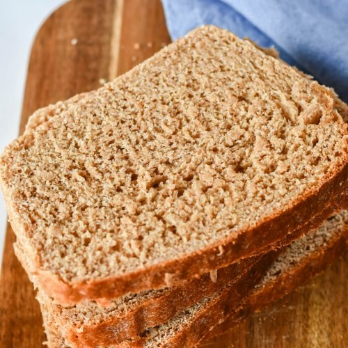 a stack of fresh sliced honey wheat sandwich bread