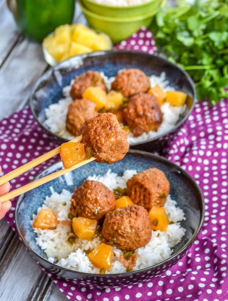 Crockpot Hawaiian Meatballs- meatballs glazed in a sweet & savory pineapple sauce with chunks of caramelized pineapple and tender green peppers over a bed of white rice
