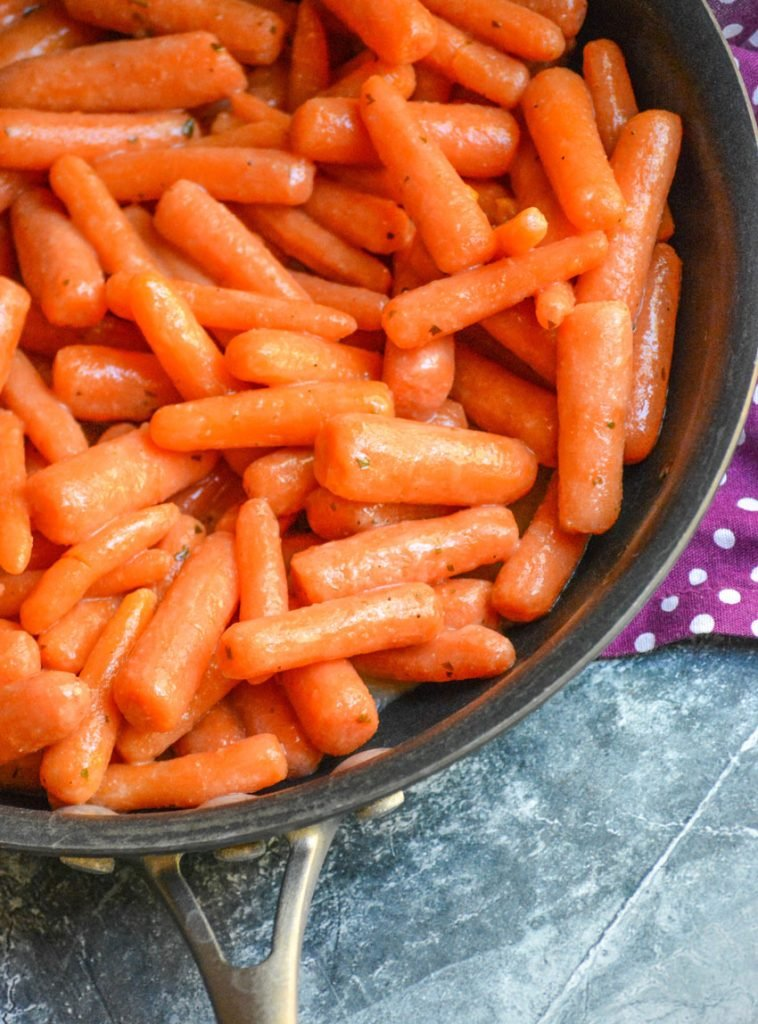 ranch glazed tender baby carrots shown in a large skillet