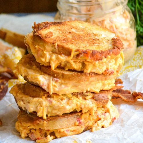 four pimento cheese grilled cheese sandwiches stacked on top of each other