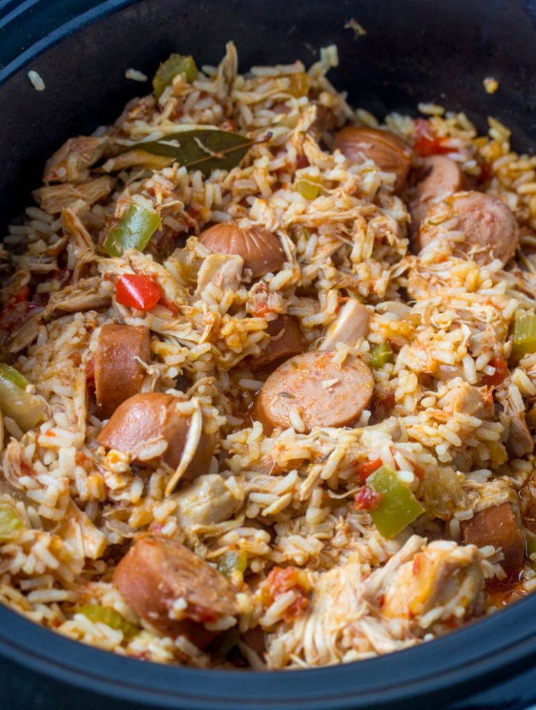 Crockpot Chicken, Sausage, & Rice shown in the black crock of a slow cooker