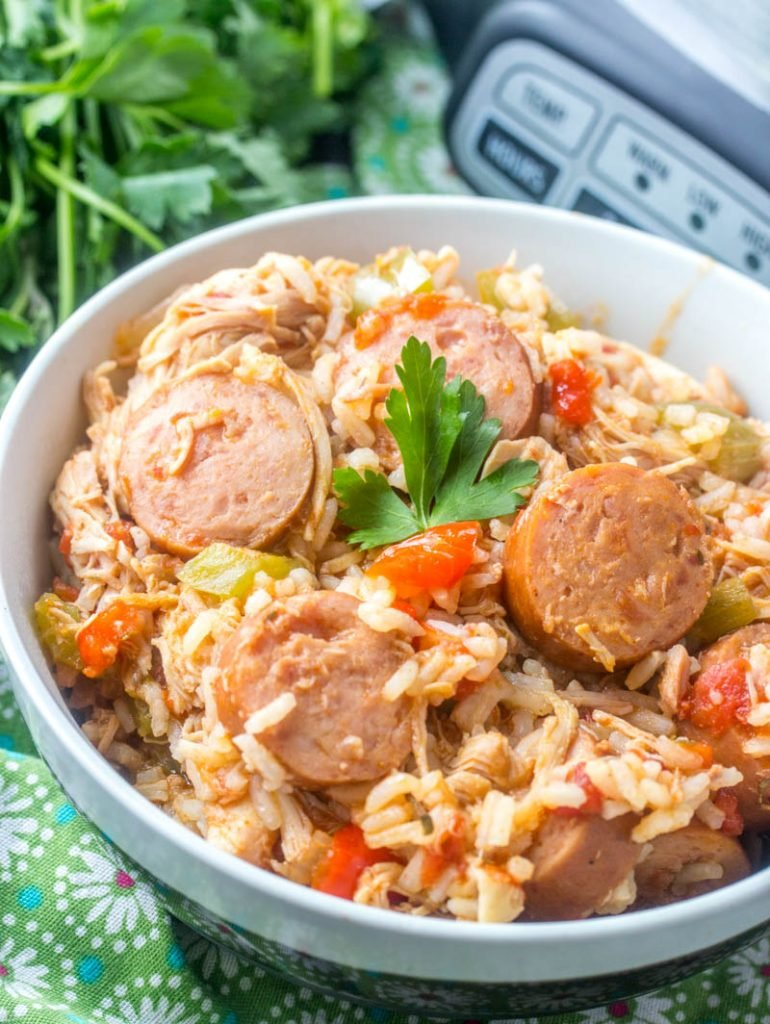 crockpot chicken sausage and rice shown served in a white bowl