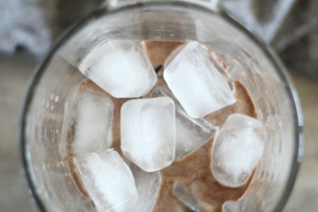 ice and hot chocolate mix shown in a blender