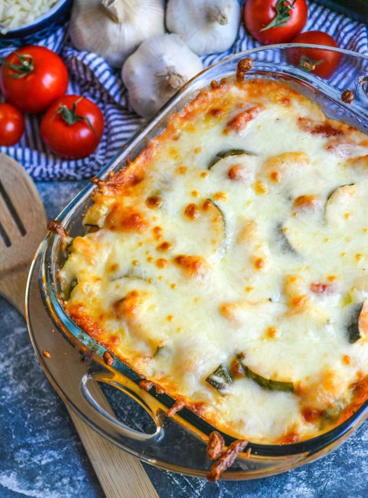 baked gnocchi with zucchini & tomatoes in a square pyrex baking dish