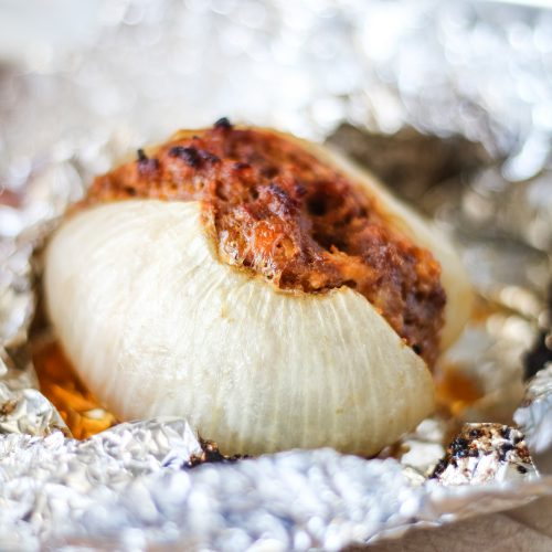 a grilled onion bomb unwrapped from its foil packet
