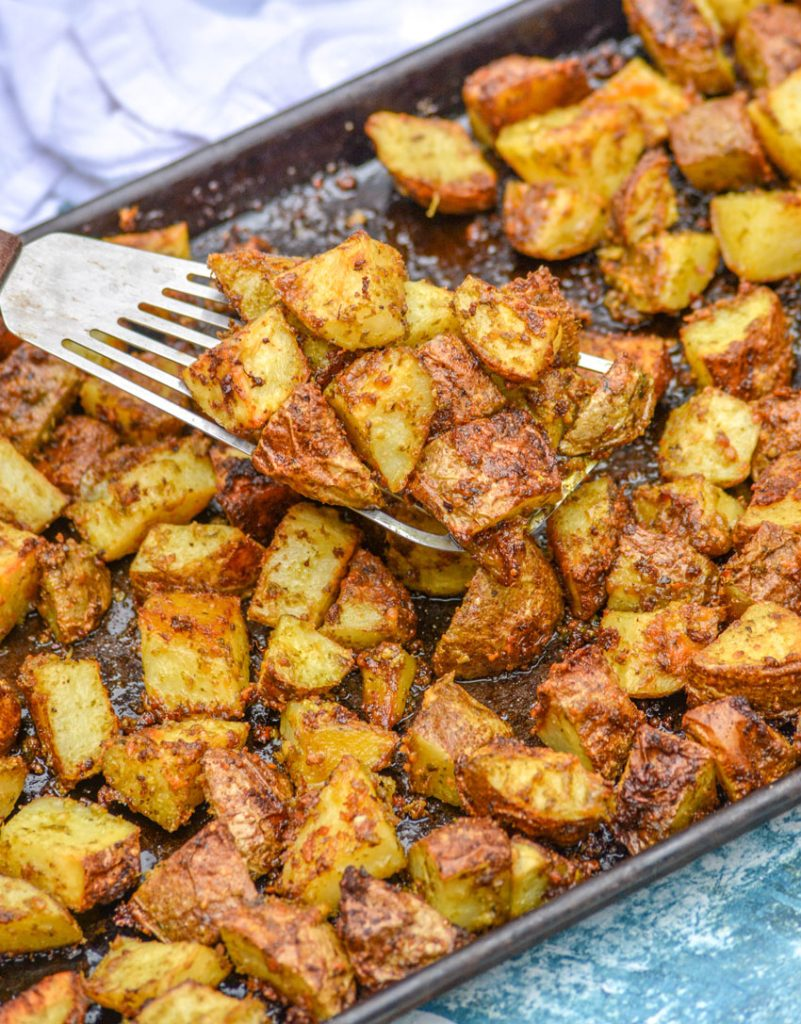 oven roasted pesto seasoned potatoes with Parmesan cheese