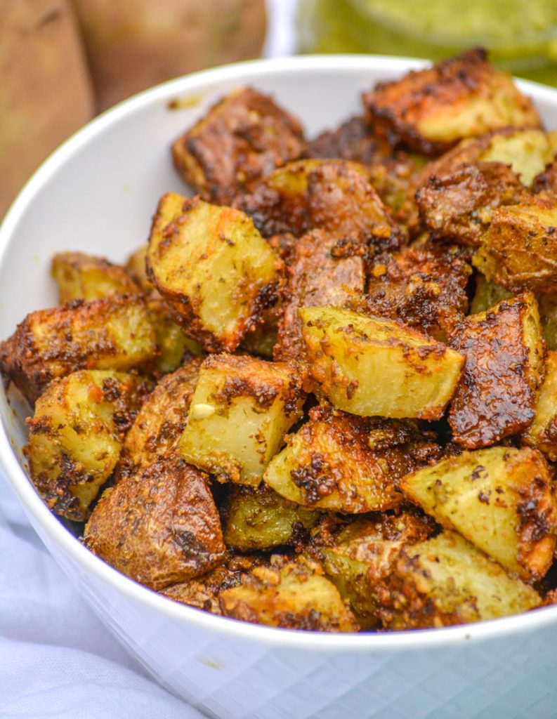 roasted potatoes with pesto and Parmesan cheese