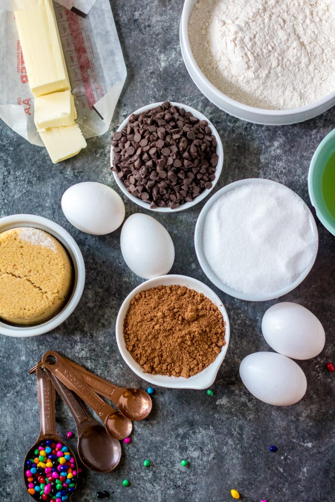 picture showing the ingredients needed to make a batch of cosmic brownies laid out on a wooden back drop