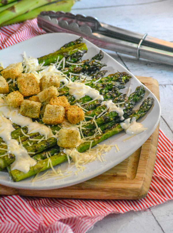 Grilled Asparagus with Garlic Croutons and a drizzle of Caesar Dressing and shredded Parmesan cheese