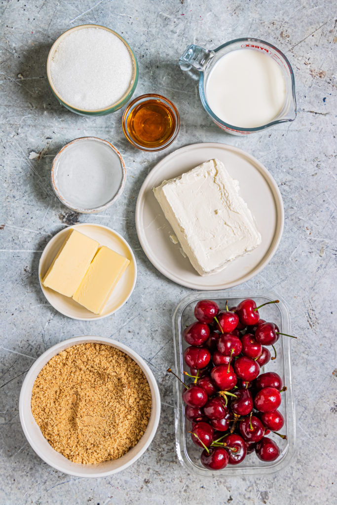 overhead shot showing all of the ingredients needed for cherry cheesecake popsicles