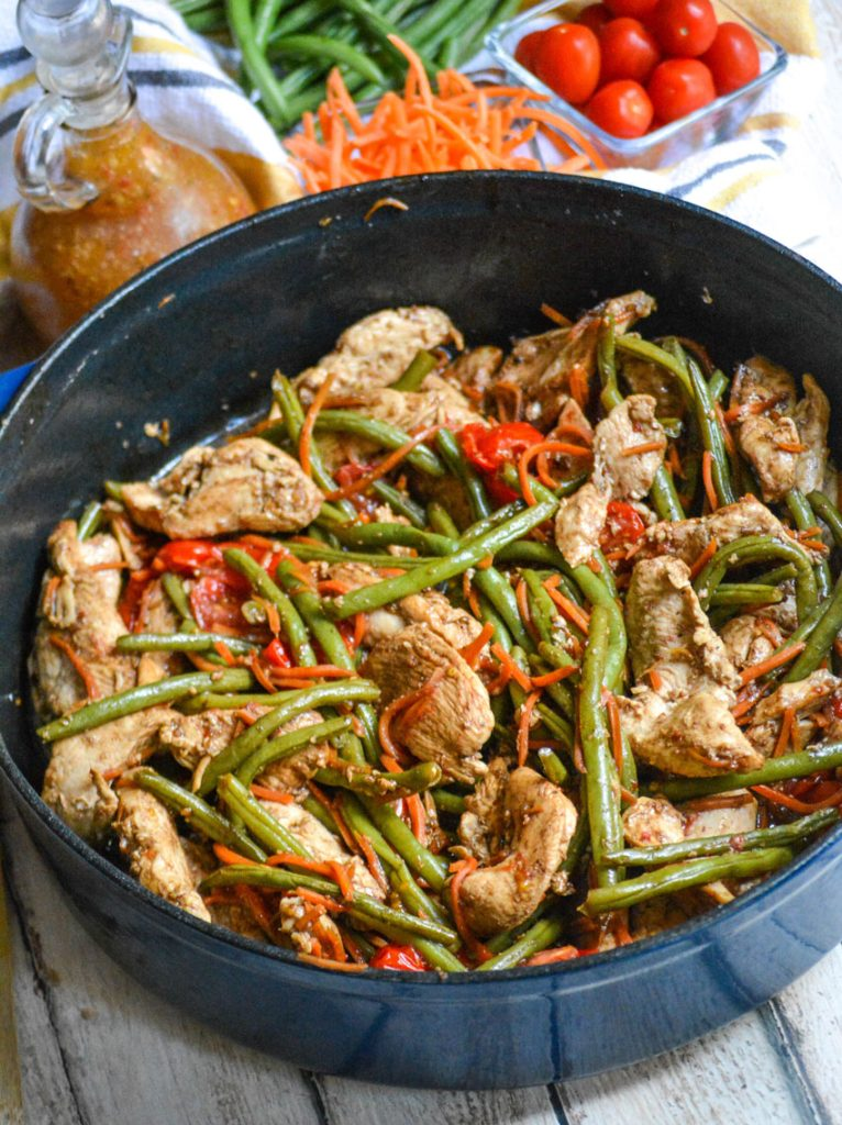 one pot balsamic chicken and veggies shown in a blue pot