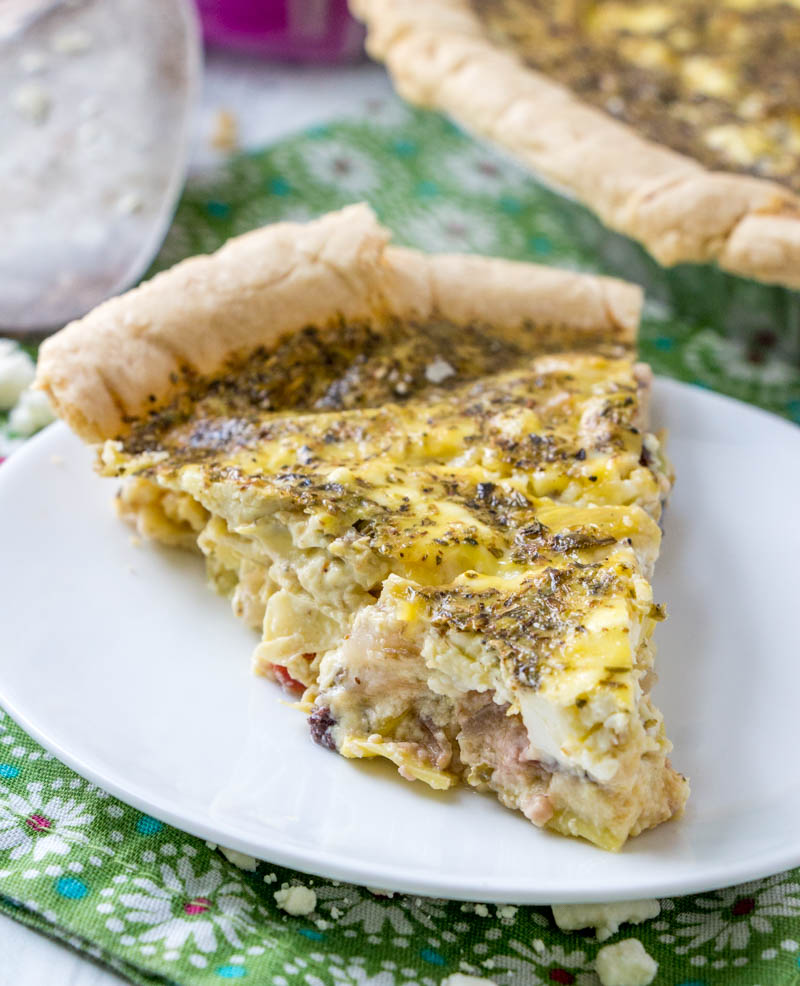 Greek Quiche with sun dried tomatoes, marinated artichokes, kalamata olives, and feta cheese