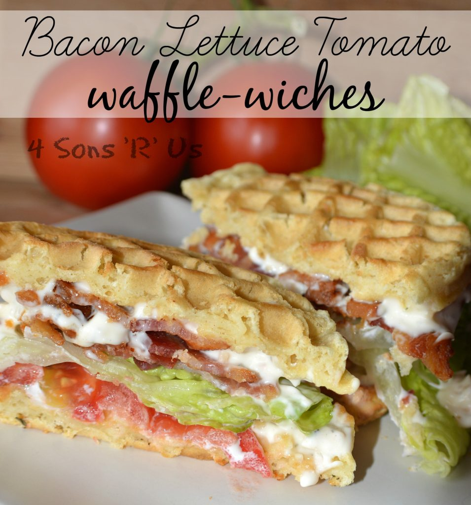 Bacon Lettuce Tomato Waffle-Wiches sandwich sliced in half and shown on a white plate with ripe tomatoes and green lettuce in the background