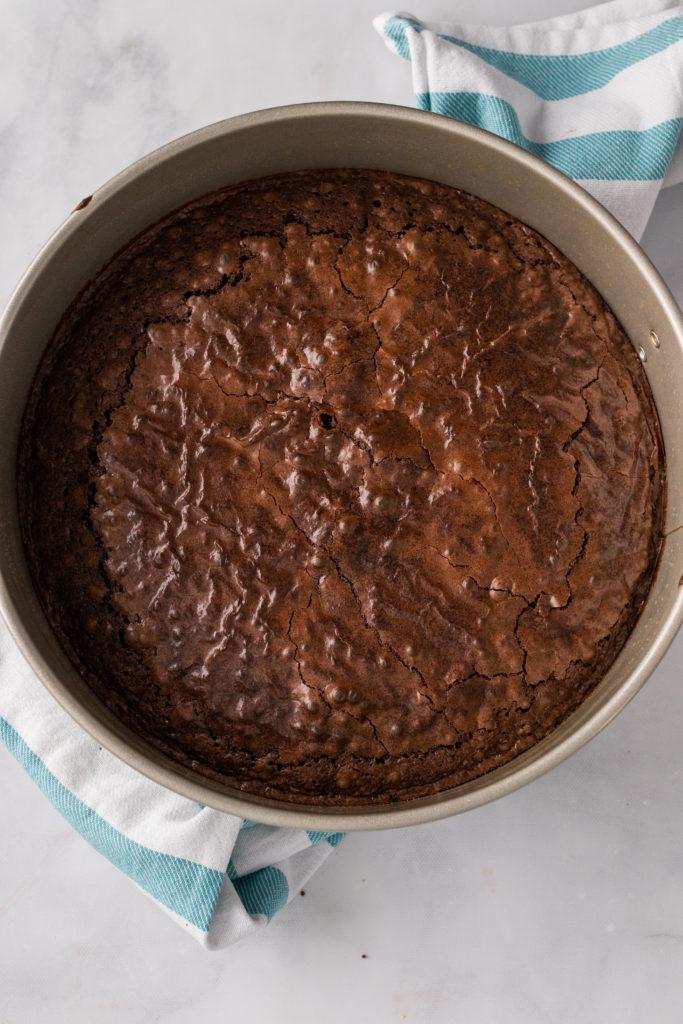 brownie crust baked in a silver springform pan