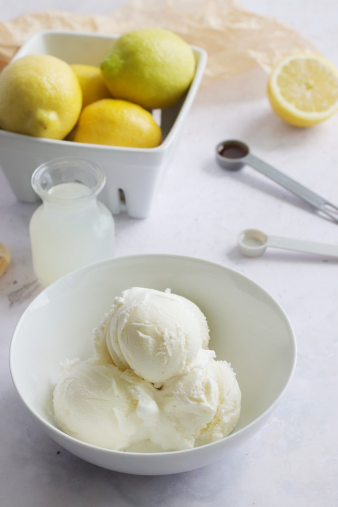 ingredients needed to make a batch of copy cat chick fil a frosted lemonade shown on a marble counter