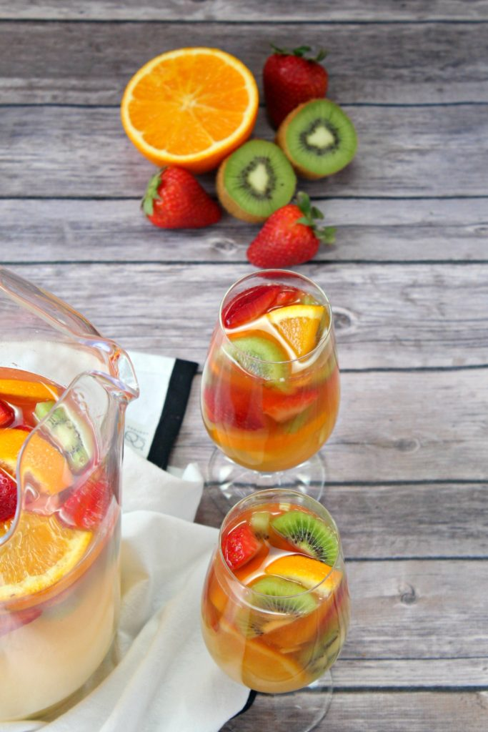 white wine, rum, pineapple, and orange juice sangria with fresh fruit