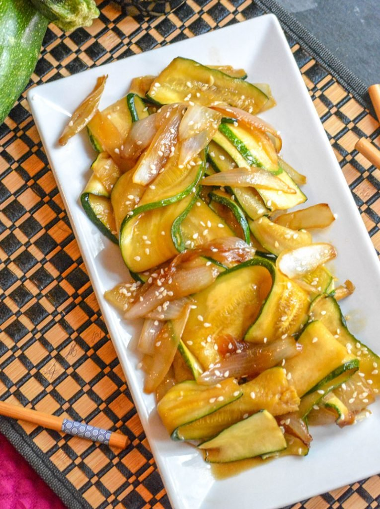 saucy, caramelized Japanese Steakhouse Hibachi Style Zucchini & Onions served on a white platter