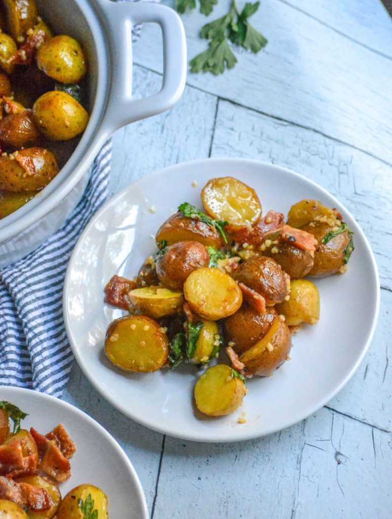 still warm roasted potatoes, bacon, & Italian parsley are tossed in a tangy homemade garlic honey mustard dressing making a simple, delicious potato salad