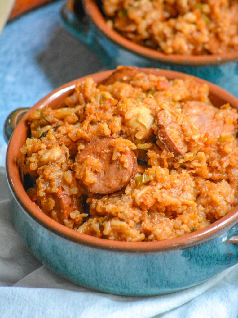 Dutch Oven Jambalaya served in blue glazed terra cotta bowls