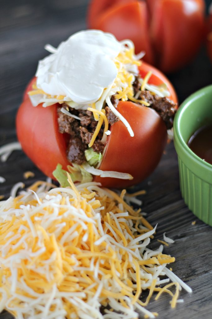 ripe tomatoes stuffed with taco seasoned ground beef and topped with lettuce cheese & sour cream