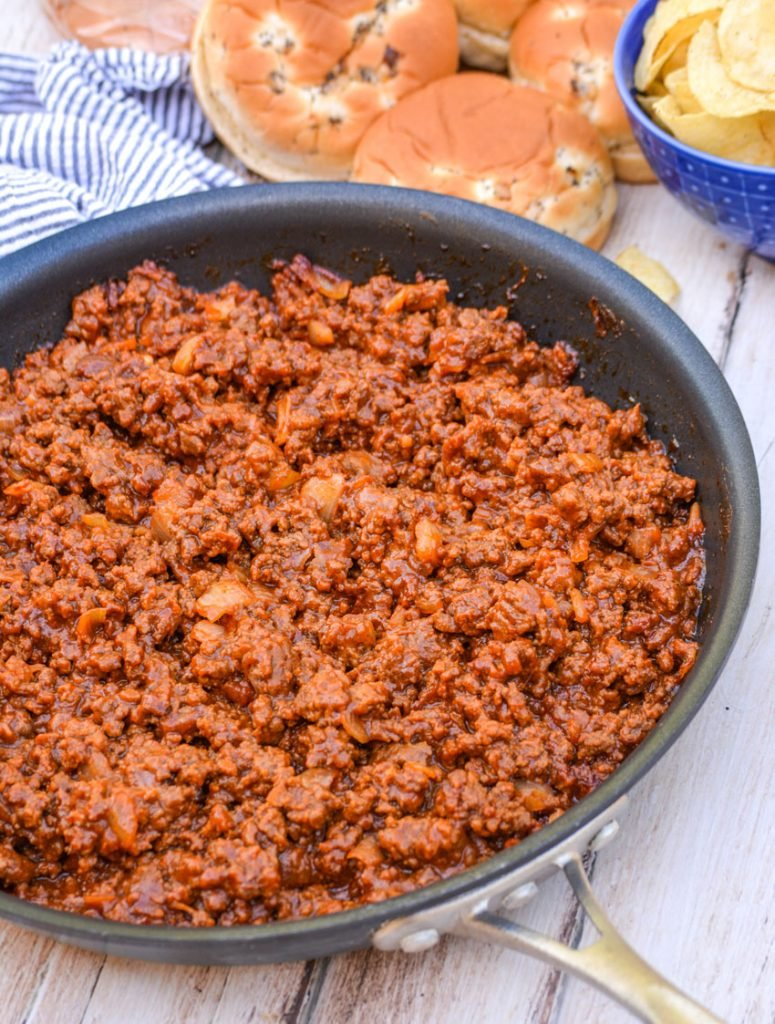 Grandma's from scratch sloppy joe ground beef mixture shown in a black non stick metal skillet