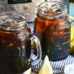 iced tea in glasses with ice with sliced lemons and an instant pot in the background