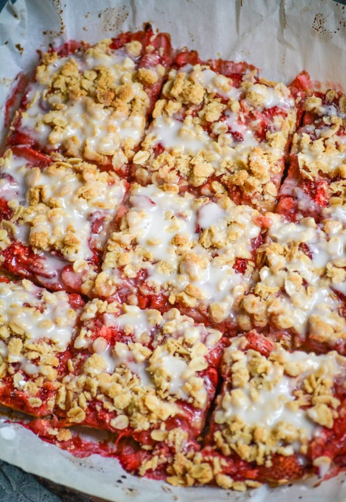 healthy strawberry oat bars on parchment paper and cut into squares