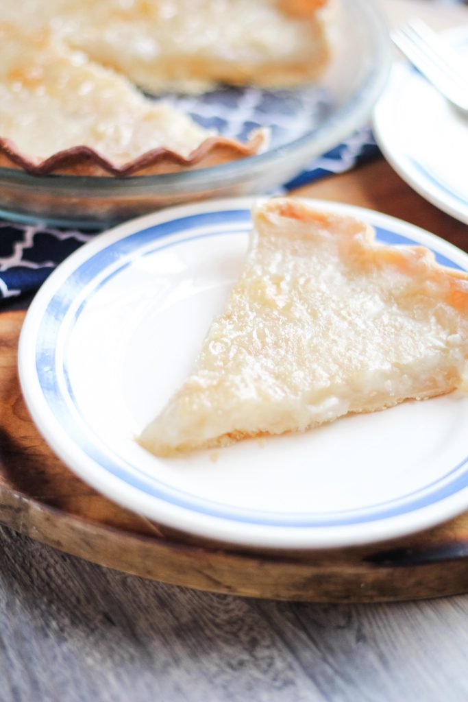 a slice of water pie on a white blue-rimmed plate