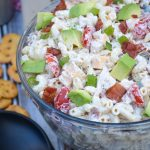 chicken club pasta salad in a large glass mixing bowl