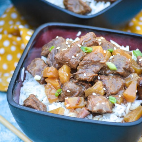 crockpot steak teriyaki served over steamed white rice in black bowls