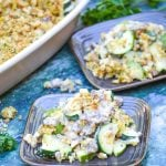 zucchini & sausage casserole shown served on brown square appetizer plates