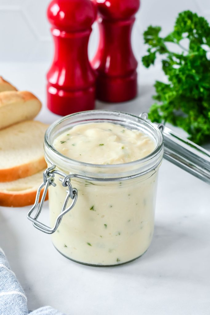 condensed cream of chicken soup shown in an open glass storage jar