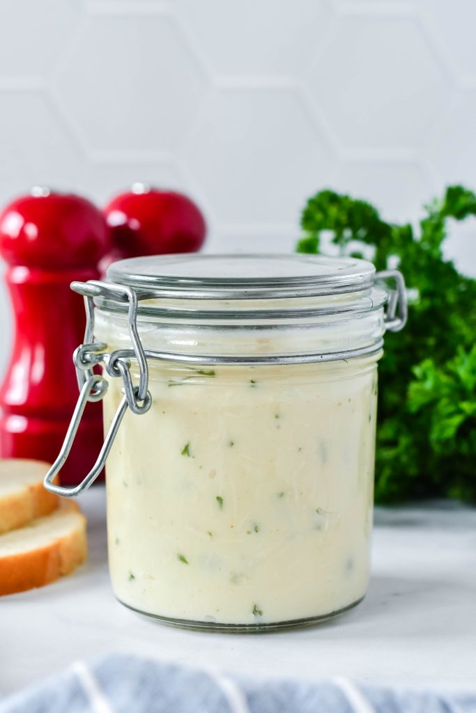 homemade cream of chicken soup shown in a sealed glass jar