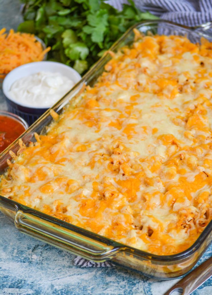 chicken tamale casserole shown served in a 9x13 inch glass pyrex dish