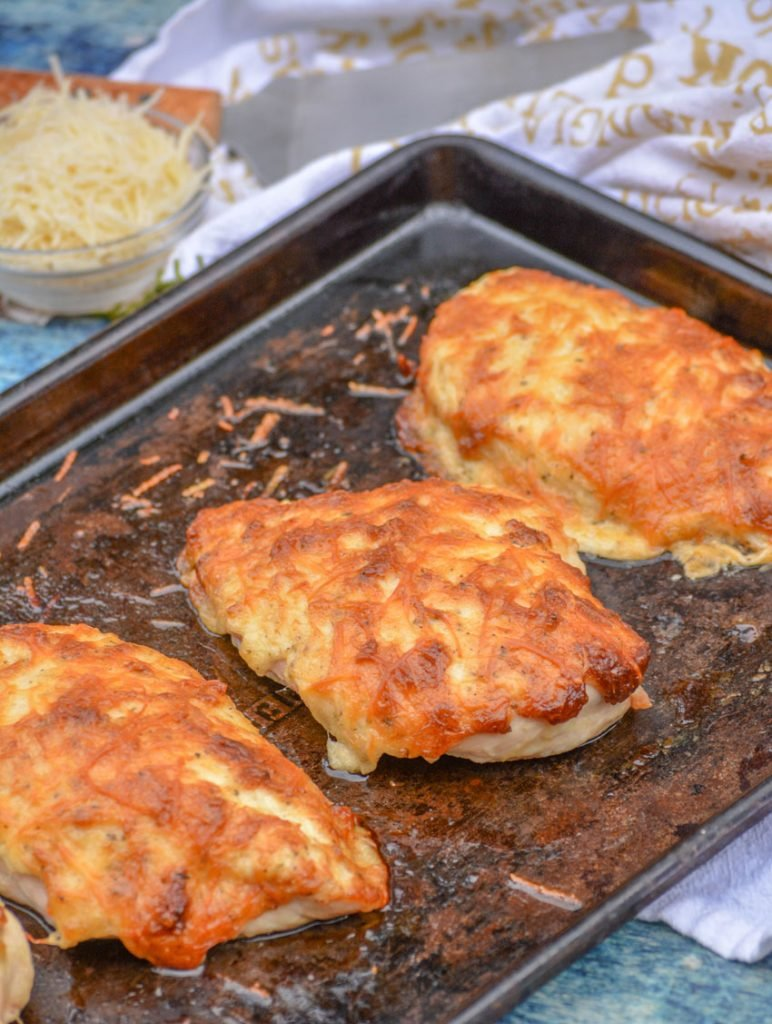 a sheet pan with mayo parmesan crusted chicken breasts