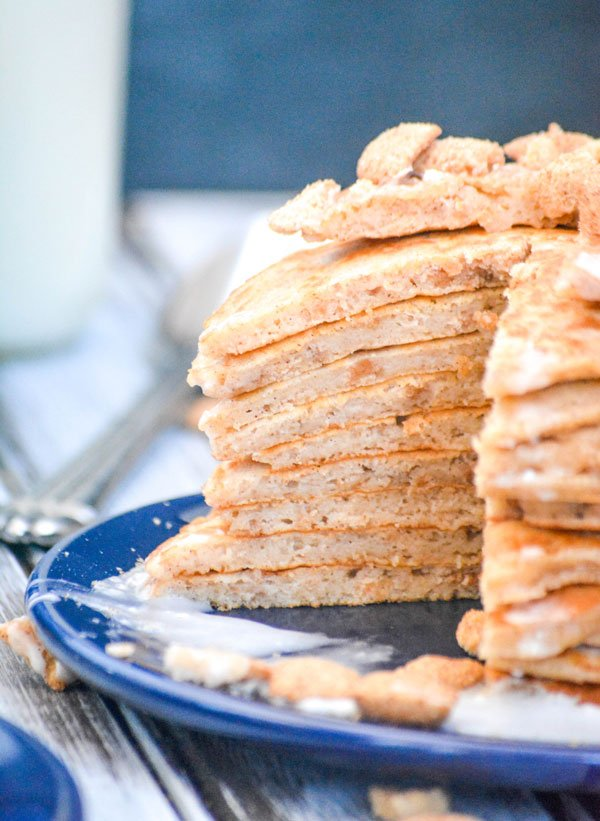 a cut open stack of cinnamon toast crunch cereal pancakes revealing the inside