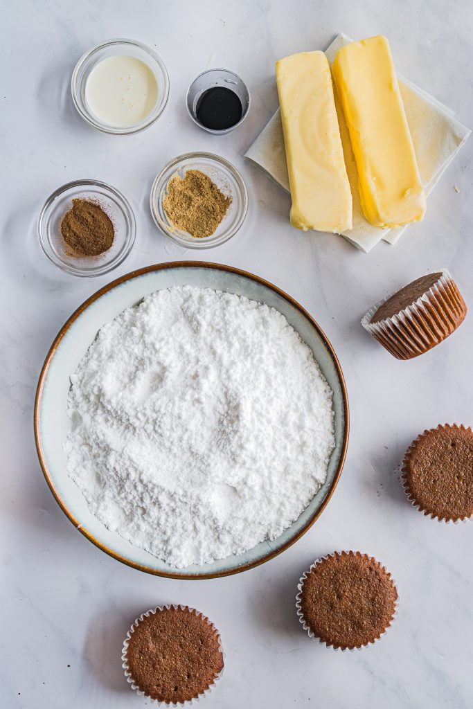 image showing all the ingredients needed to make spiced buttercream frosting for frosted gingerbread cupcakes