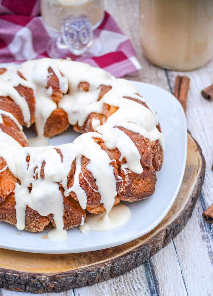 eggnog monkey bread shown served on a large white plate