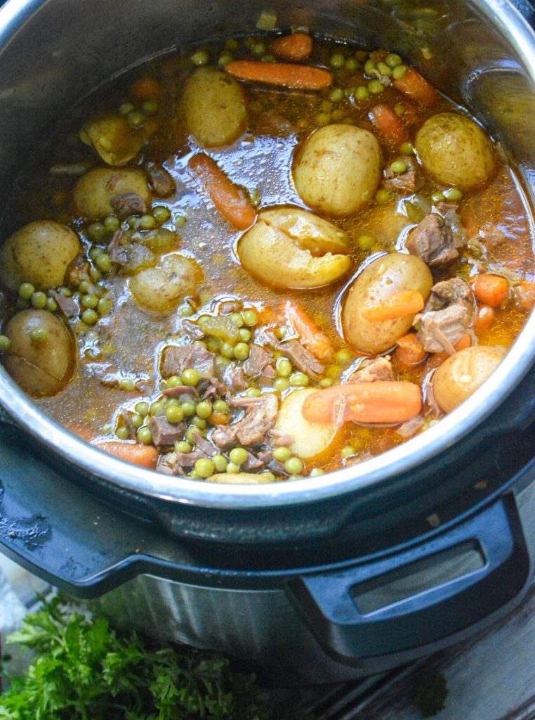 savory beef stew shown in the bowl of an instant pot