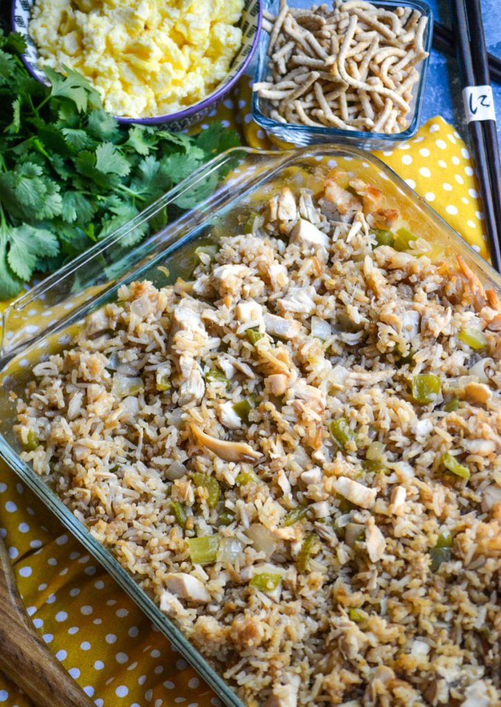 oven baked chicken fried rice in a clear glass pyrex baking dish