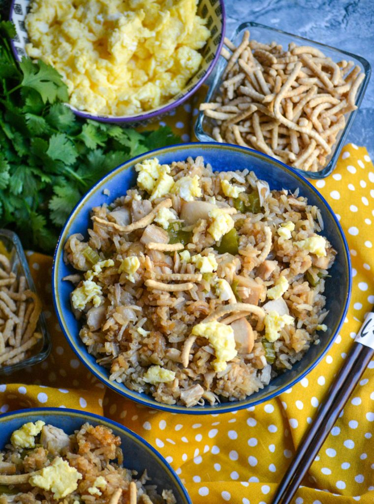 oven baked chicken fried rice shown in a blue bowl