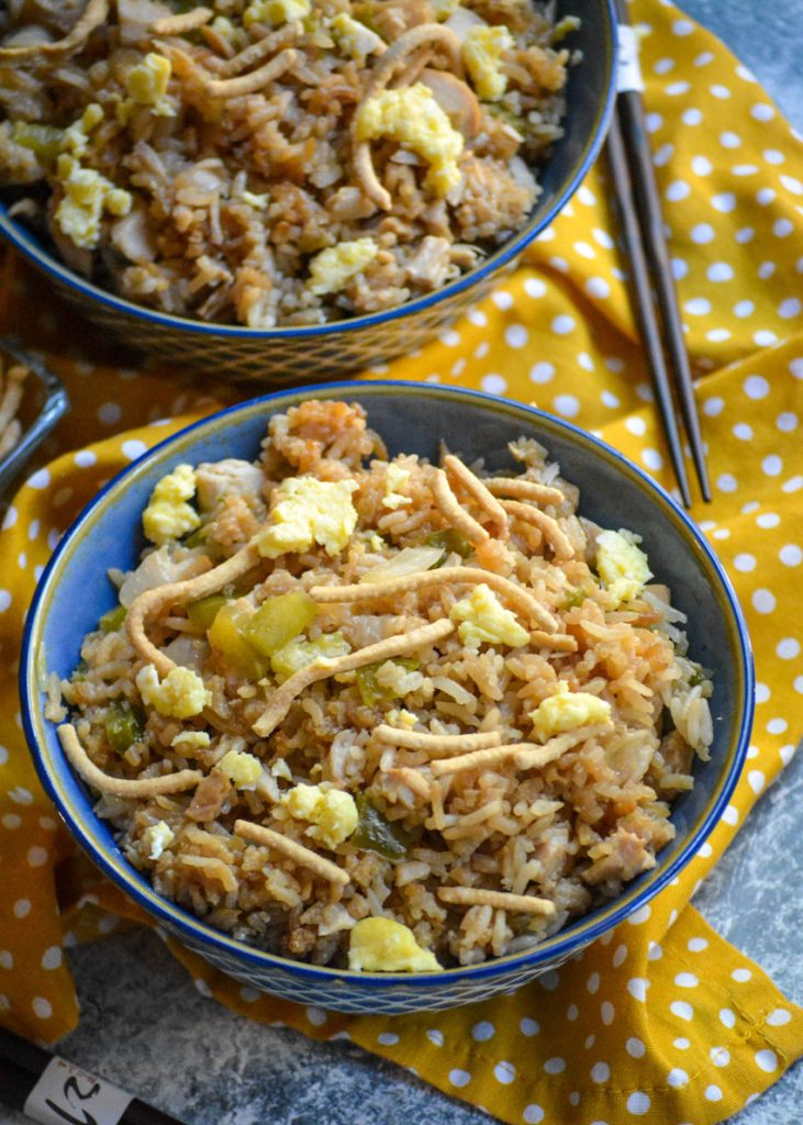 oven baked chicken fried rice shown in a blue bowls