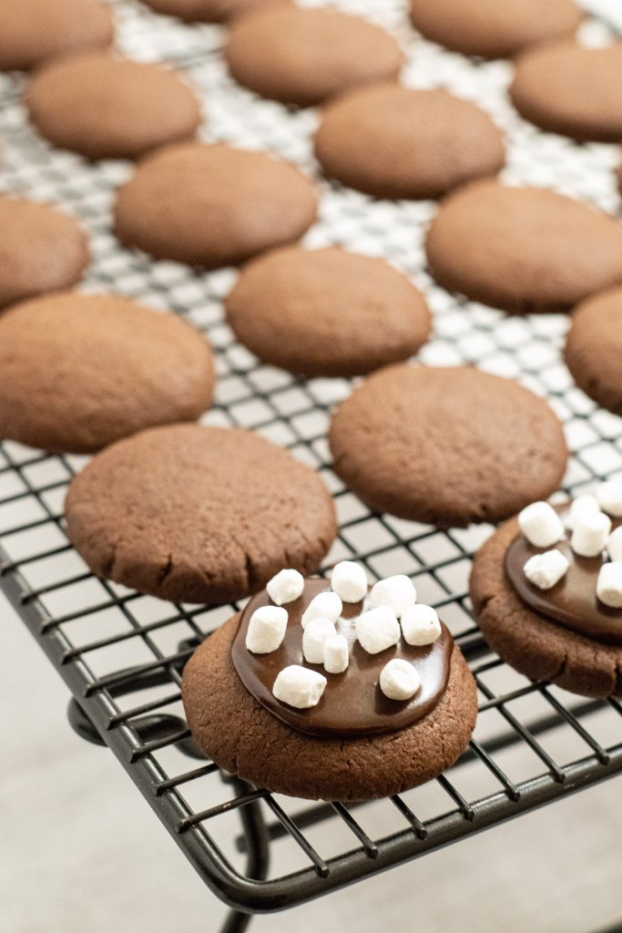 hot chocolate cookies shown on a metal wire cooling rack
