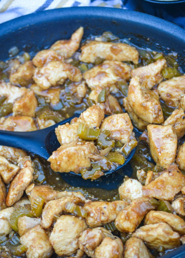 copycat panda express black pepper chicken shown in a black skillet