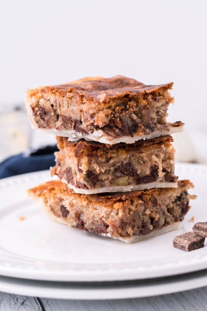cookie pie bars stacked three high on a white plate