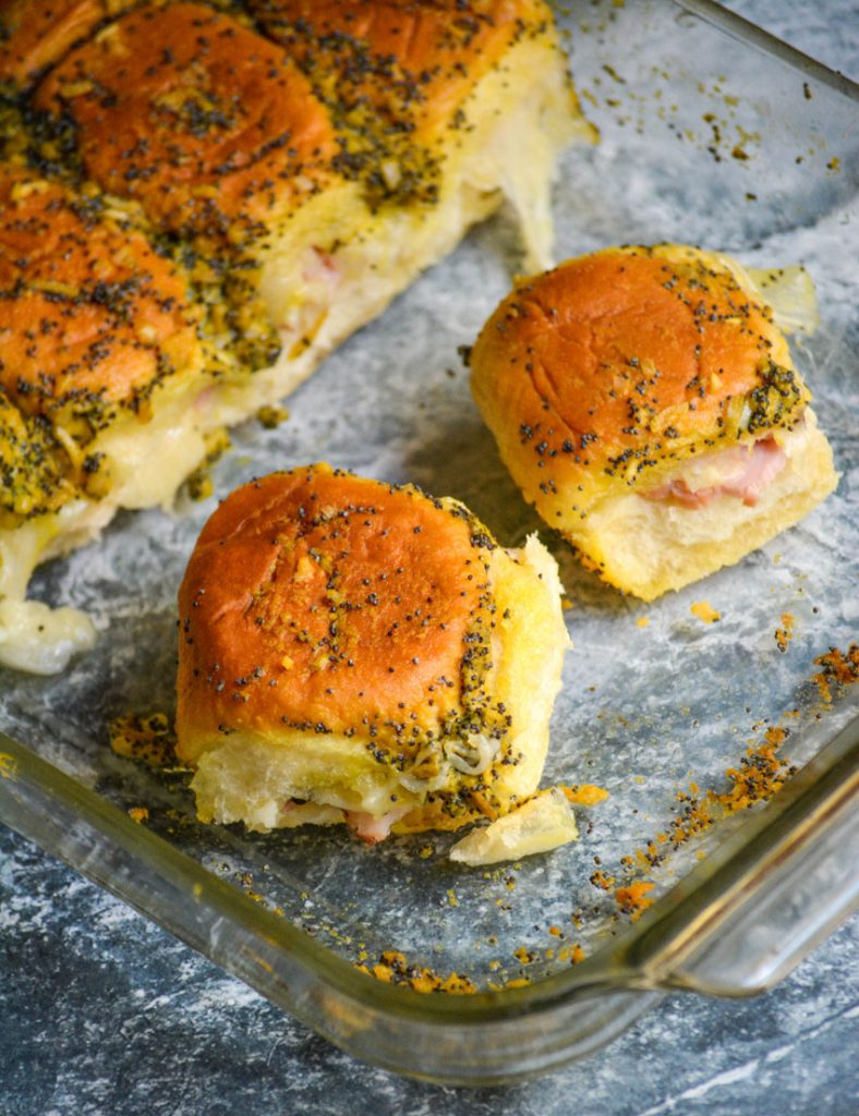 ham and cheese sliders shown in a glass baking dish
