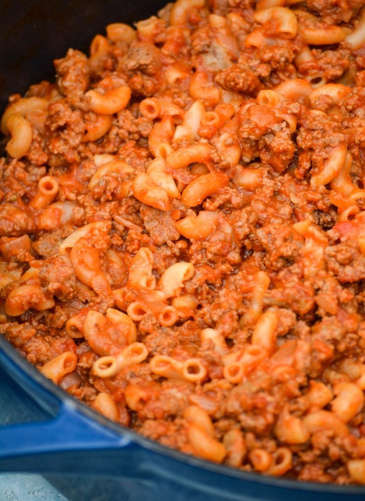 homemade beefaroni shown in a blue enameled cast iron pot