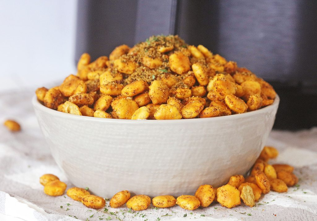 a white bowl filled with air fryer taco seasoned oyster crackers