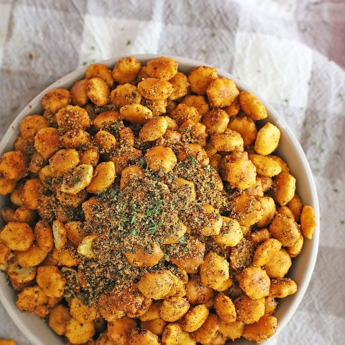 a white bowl filled with taco seasoned oyster crackers